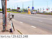 Купить «Traffic enforcement camera and vehicles in motion on city street», фото № 29623248, снято 12 июня 2018 г. (c) FotograFF / Фотобанк Лори