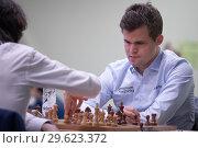 Купить «Чемпион мира Magnus Carlsen, Норвегия (справа) на чемпионате мира по быстрым шахматам в Санкт-Петербурге», фото № 29623372, снято 28 декабря 2018 г. (c) Stockphoto / Фотобанк Лори