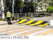 Купить «Road barrier with yellow and black striped caution pattern,», фото № 29625356, снято 23 июня 2018 г. (c) FotograFF / Фотобанк Лори