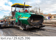 Купить «Work on laying the asphalt surface on a city street», фото № 29625396, снято 29 апреля 2018 г. (c) FotograFF / Фотобанк Лори