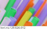 Купить «Top view of colorful straw on the rotation table», видеоролик № 29626012, снято 23 июля 2019 г. (c) Dzmitry Astapkovich / Фотобанк Лори