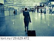 """Купить «Стюардесса компании """"Аэрофлот"""" в Шереметьево», фото № 29629472, снято 4 мая 2018 г. (c) Victoria Demidova / Фотобанк Лори"""