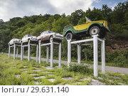 Nagorno Karabakh Republic, Vank, Seastone Hotel, Soviet-era cars on pedestals. Стоковое фото, фотограф Walter Bibikow / age Fotostock / Фотобанк Лори
