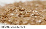 Купить «Pile of flax seeds on rotating table, macro view, healthy food», видеоролик № 29632424, снято 9 июля 2020 г. (c) Dzmitry Astapkovich / Фотобанк Лори