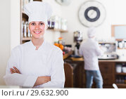 Купить «portrait of young satisfied woman baker with tasty cakes and rolls», фото № 29632900, снято 22 апреля 2017 г. (c) Яков Филимонов / Фотобанк Лори