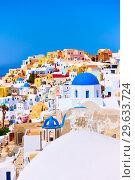 Купить «Colorful view of Oia town in Santorini», фото № 29633724, снято 24 апреля 2018 г. (c) Роман Сигаев / Фотобанк Лори
