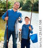 Купить «Portrait of father and son fishing with rods», фото № 29637108, снято 17 июня 2019 г. (c) Яков Филимонов / Фотобанк Лори