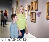 Купить «Mother and son regarding paintings in halls of museum», фото № 29637124, снято 18 марта 2017 г. (c) Яков Филимонов / Фотобанк Лори