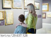 Купить «Mother and son regarding paintings in halls of museum», фото № 29637128, снято 18 марта 2017 г. (c) Яков Филимонов / Фотобанк Лори