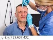 Купить «Female doctor is doing injection to patient in skin of face», фото № 29637432, снято 20 марта 2019 г. (c) Яков Филимонов / Фотобанк Лори
