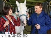Купить «Portrait of couple standing at stable», фото № 29637480, снято 26 ноября 2018 г. (c) Яков Филимонов / Фотобанк Лори