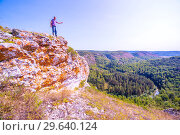 Купить «A tourist stands on top of a mountain and admires from above a view of the Ural taiga. Bashkortostan.», фото № 29640124, снято 1 сентября 2018 г. (c) Акиньшин Владимир / Фотобанк Лори