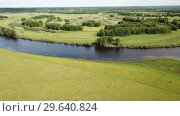 Купить «Panoramic view of gulf meadows in the floodplain of the Oka River, Russia», видеоролик № 29640824, снято 27 июня 2018 г. (c) Яков Филимонов / Фотобанк Лори