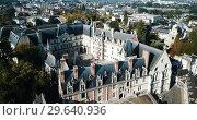 Купить «View from drone of impressive Royal Chateau de Blois on background with cityscape in sunny autumn day, France», видеоролик № 29640936, снято 25 октября 2018 г. (c) Яков Филимонов / Фотобанк Лори