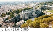 Купить «Aerial view of ruined medieval castle of Chateau de Beaucaire on background of French commune of Beaucaire», видеоролик № 29640980, снято 24 октября 2018 г. (c) Яков Филимонов / Фотобанк Лори