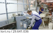 Купить «Qualified workman working with glass in industrial workshop», видеоролик № 29641036, снято 16 октября 2018 г. (c) Яков Филимонов / Фотобанк Лори