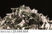 Купить «A bunch of crumpled fifty-dollar bills rotate on a black background close-up», видеоролик № 29644664, снято 29 декабря 2018 г. (c) Алексей Кузнецов / Фотобанк Лори