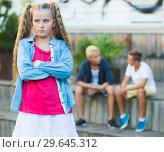 Купить «Sad girl having problems in relationship with friends», фото № 29645312, снято 27 июля 2017 г. (c) Яков Филимонов / Фотобанк Лори