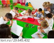 Купить «Female teacher and pupils working in classroom», фото № 29645432, снято 15 ноября 2018 г. (c) Яков Филимонов / Фотобанк Лори