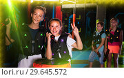 Купить «Girl and boy with laser pistols in laser tag labyrinth», фото № 29645572, снято 15 октября 2019 г. (c) Яков Филимонов / Фотобанк Лори