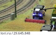 Купить «Harvester Combine harvest near railroad», видеоролик № 29645848, снято 5 августа 2016 г. (c) Потийко Сергей / Фотобанк Лори