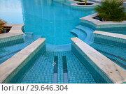 Купить «Descent to the pool made in shape of a semicircle», фото № 29646304, снято 3 ноября 2018 г. (c) Володина Ольга / Фотобанк Лори