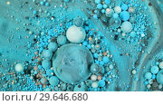 Купить «Colorful paint in bubbles organically moves in the liquid», видеоролик № 29646680, снято 5 июля 2020 г. (c) Dzmitry Astapkovich / Фотобанк Лори