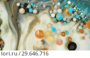 Купить «Colorful paint in bubbles organically moves in the liquid», видеоролик № 29646716, снято 5 июля 2020 г. (c) Dzmitry Astapkovich / Фотобанк Лори