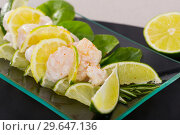 Купить «Ceviche from alaska pollock on a glass plate with lime and herbs», фото № 29647136, снято 19 января 2019 г. (c) Яков Филимонов / Фотобанк Лори