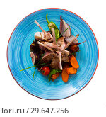 Купить «Top view of baked lamb ribs with vegetables, figs, demi-glace», фото № 29647256, снято 19 апреля 2019 г. (c) Яков Филимонов / Фотобанк Лори
