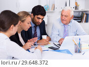 Купить «Employees are writing financial reports», фото № 29648372, снято 27 июня 2017 г. (c) Яков Филимонов / Фотобанк Лори