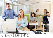 Купить «Upset girl sitting at laptop in coworking space while dissatisfied businessman pointing out mistakes in her work», фото № 29648412, снято 1 августа 2018 г. (c) Яков Филимонов / Фотобанк Лори