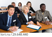 Купить «International group of business people listening to presentation at tables», фото № 29648440, снято 12 февраля 2018 г. (c) Яков Филимонов / Фотобанк Лори