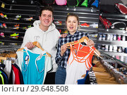 Купить «Couple demonstraiting new sportwear», фото № 29648508, снято 7 февраля 2018 г. (c) Яков Филимонов / Фотобанк Лори