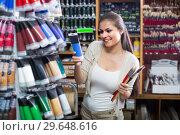 Купить «woman choosing paint color in tube», фото № 29648616, снято 21 февраля 2019 г. (c) Яков Филимонов / Фотобанк Лори