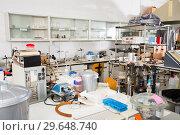 Купить «Interior of chemical laboratory equipped with different tools», фото № 29648740, снято 28 ноября 2018 г. (c) Яков Филимонов / Фотобанк Лори