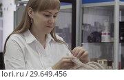 Купить «Woman Hairdresser With Long Hair Does Hair Style With Electro Ironing», видеоролик № 29649456, снято 26 мая 2020 г. (c) Pavel Biryukov / Фотобанк Лори
