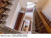 Купить «Staircase with tracery railing and carpet in the Konstantinovsky (Congress) Palace in Strelna», фото № 29658092, снято 9 августа 2017 г. (c) FotograFF / Фотобанк Лори