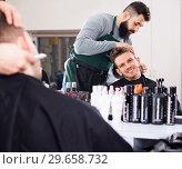 Купить «Male hairdresser accurately cutting beard», фото № 29658732, снято 27 января 2017 г. (c) Яков Филимонов / Фотобанк Лори