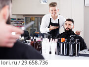 Купить «happy guy stylist demonstrating final haircut to client at hairdressing salon», фото № 29658736, снято 27 января 2017 г. (c) Яков Филимонов / Фотобанк Лори