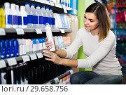 Купить «Girl customer looking for effective deodorant in supermarket», фото № 29658756, снято 23 ноября 2016 г. (c) Яков Филимонов / Фотобанк Лори