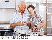 Купить «Perplexed woman and senior man with mixer tap», фото № 29658832, снято 19 июня 2018 г. (c) Яков Филимонов / Фотобанк Лори