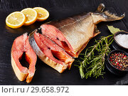 Купить «close-up of smoked wild salmon cut in steaks», фото № 29658972, снято 31 декабря 2018 г. (c) Oksana Zh / Фотобанк Лори