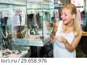 Купить «young woman in bijouterie store», фото № 29658976, снято 26 марта 2019 г. (c) Яков Филимонов / Фотобанк Лори