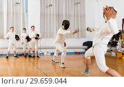 Купить «fencers looking at fencing duel», фото № 29659044, снято 30 мая 2018 г. (c) Яков Филимонов / Фотобанк Лори