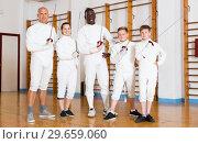 Купить «Portrait of successful adult and teen fencers», фото № 29659060, снято 30 мая 2018 г. (c) Яков Филимонов / Фотобанк Лори