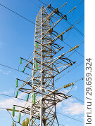 Купить «High voltage electric tower against the blue sky. Power transmission line», фото № 29659324, снято 8 октября 2017 г. (c) FotograFF / Фотобанк Лори