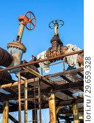 Купить «Old rusty pipeline with valves against the blue sky background», фото № 29659328, снято 10 февраля 2018 г. (c) FotograFF / Фотобанк Лори