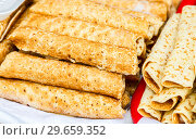 Купить «Russian traditional food. Appetizing fried pancakes on the Pancake Week», фото № 29659352, снято 18 февраля 2018 г. (c) FotograFF / Фотобанк Лори