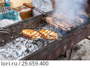 Купить «Appetizing pieces of grilled fish and meat cooked on the grill over the hot coals», фото № 29659400, снято 18 февраля 2018 г. (c) FotograFF / Фотобанк Лори